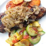 New York Strip with both sautéed cremini mushrooms and Vidalia onions, and topped with a creamy bordelaise sauce