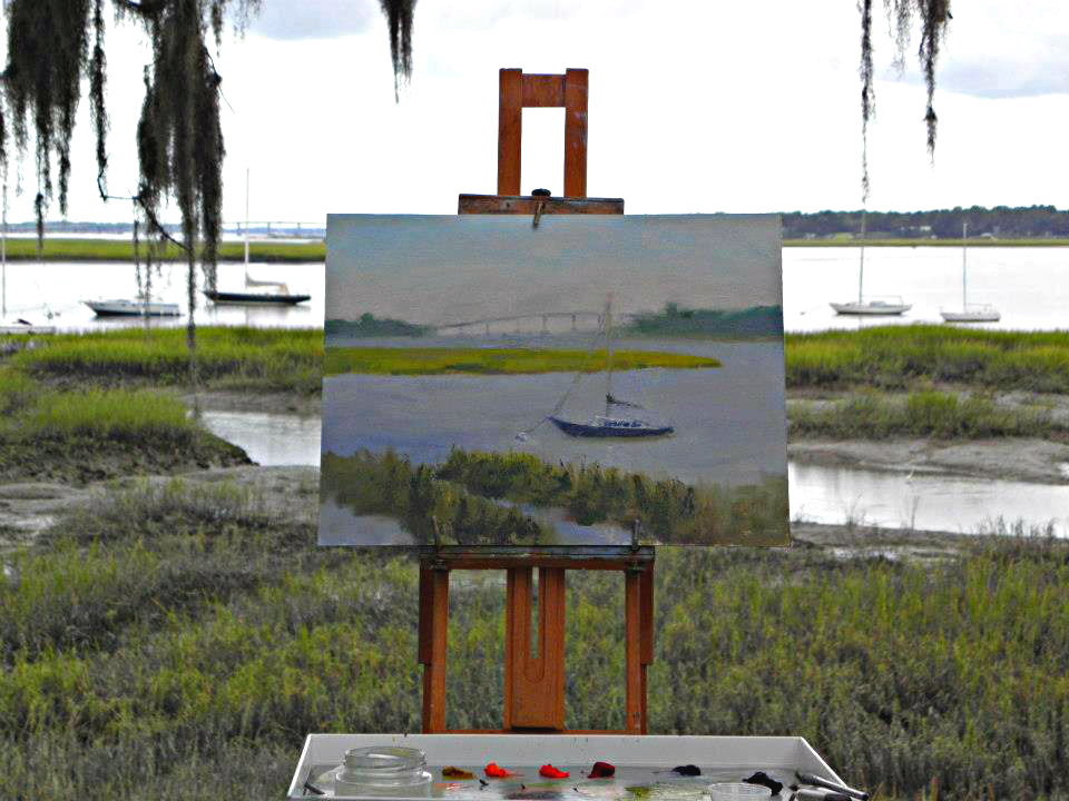 Easel set up along the bluff on Bay Street overlooking the waterfront marshes.