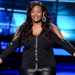 Candice Glover celebrates being declared 'safe' by host Ryan Seacrest on a Results Show episode of American Idol.