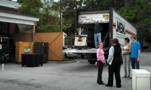 Management and employees talk outside of the Red Lobster as crews load up trucks.
