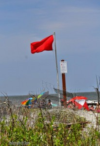 Stay safe in the water thsi season Photo of red flag on Hunting Island Beach by Dawn Ramsey
