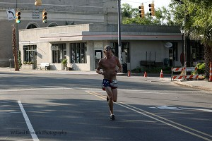 Tim Price, of Fripp Island took first place overall, with a scorching time of 17:47. He was hard to miss as he flew ahead of the field in his lucky American flag shorts and bandana.  Photo by Ryan Smith