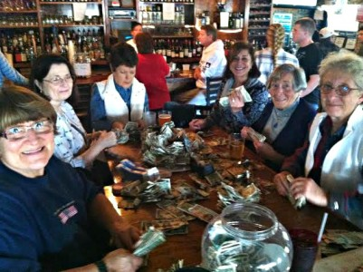 Dollars come down: Johnson Creek Tavern donates wallcovering to charity