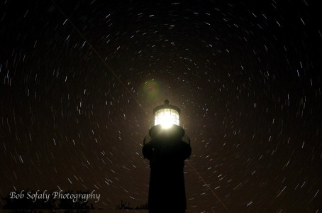 Photo of Hunting Island Lighthouse lit up at night. Photo by Bob Sofaly Photography