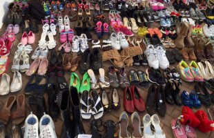 Childrens' shoes on display sending message in Port Royal