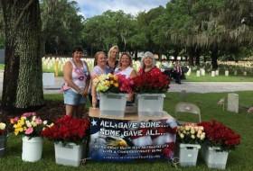 Local florist Carolina Floral Design hands out over 800 roses ar Memorial Day Ceremony.  Photo courtesy Sylvia Bushey