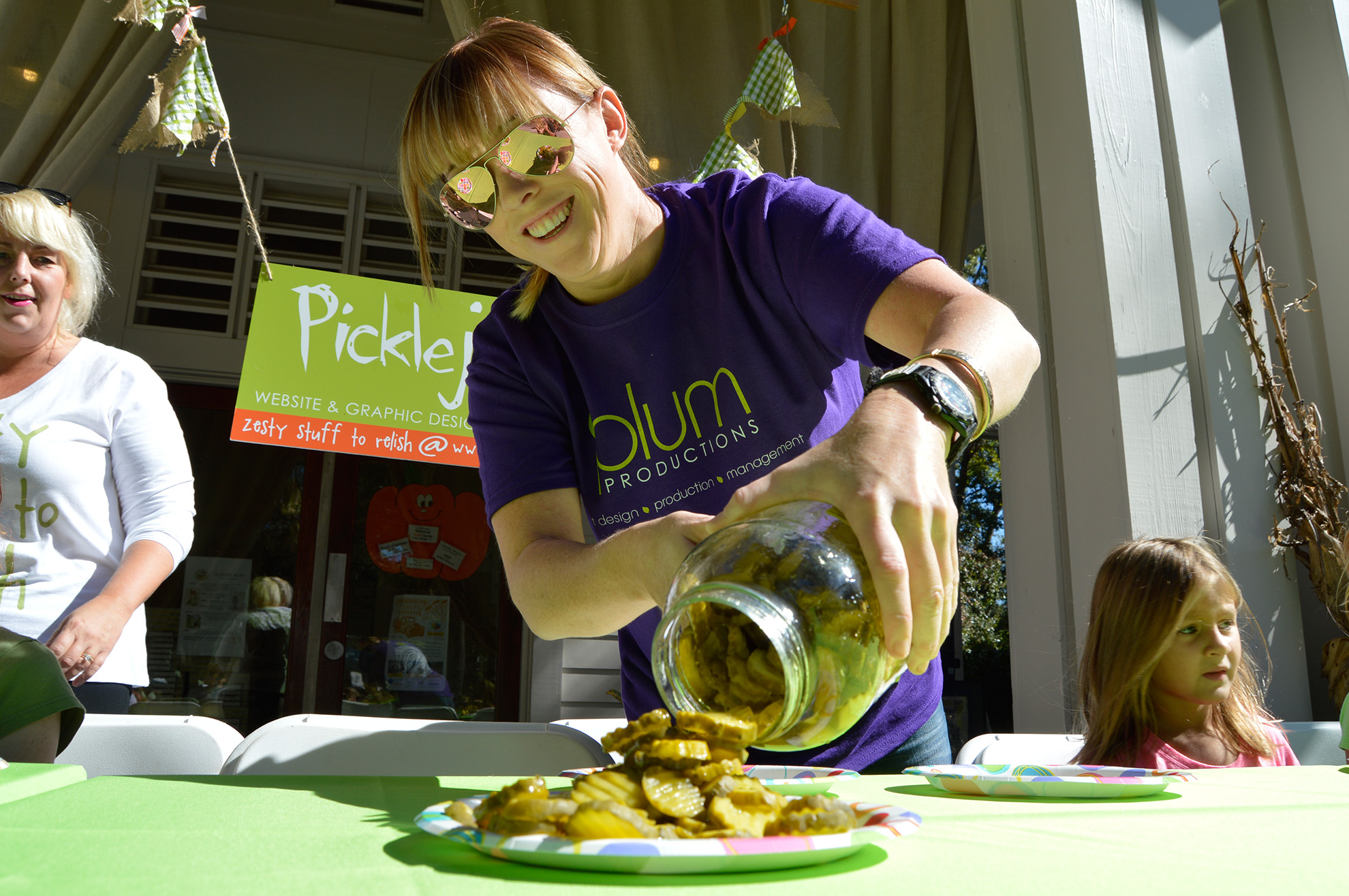 Jodie Miller loads the plates at the Pickle Eating Contest at the annual Habersham Harvest Festival.  ESPB photo