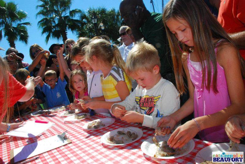 Children enjoy a shrimp peeling competition at the Beaufort Shrimp Festival.