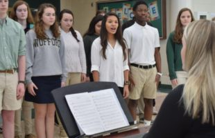 Beaufort High School Voices, a choir group, performed at the entrance of the school Wednesday, practicing their songs to be performed at the Presidential Inaugural Heritage Festival on Saturday.  Photo Jessicah Lawrence/Beaufort Today