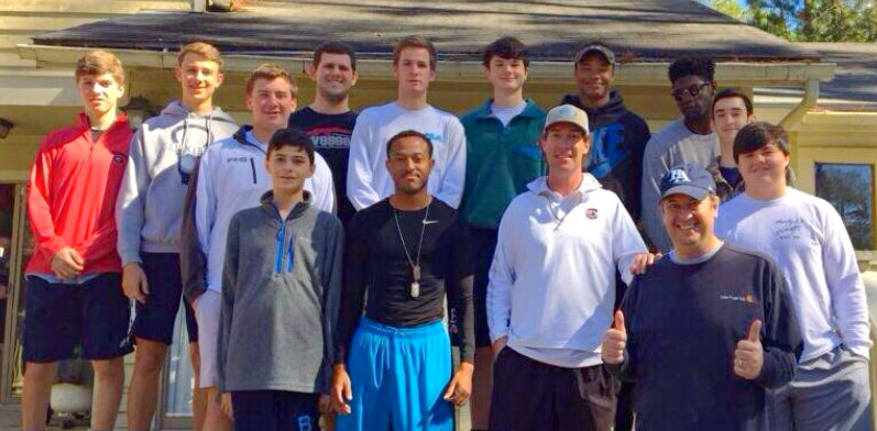 Chip Dinkins, front right, poses with members of his team and athletic director Neal McCarty