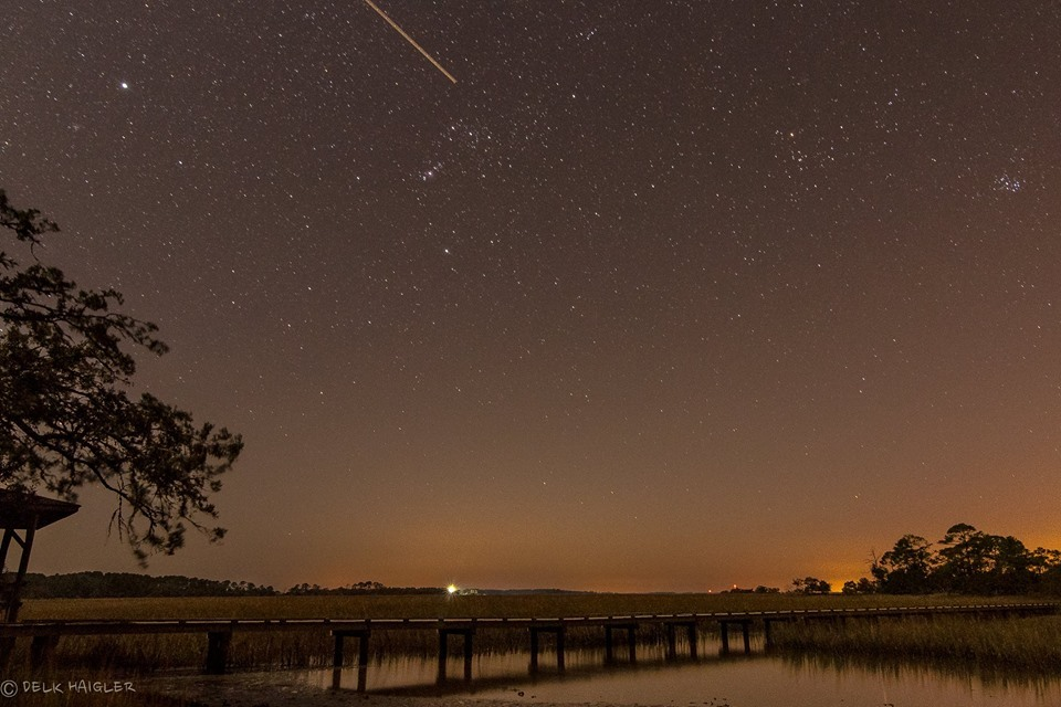 A meteor shoots through the sky over Hunting Island State Park. Photo by Delk Haigler