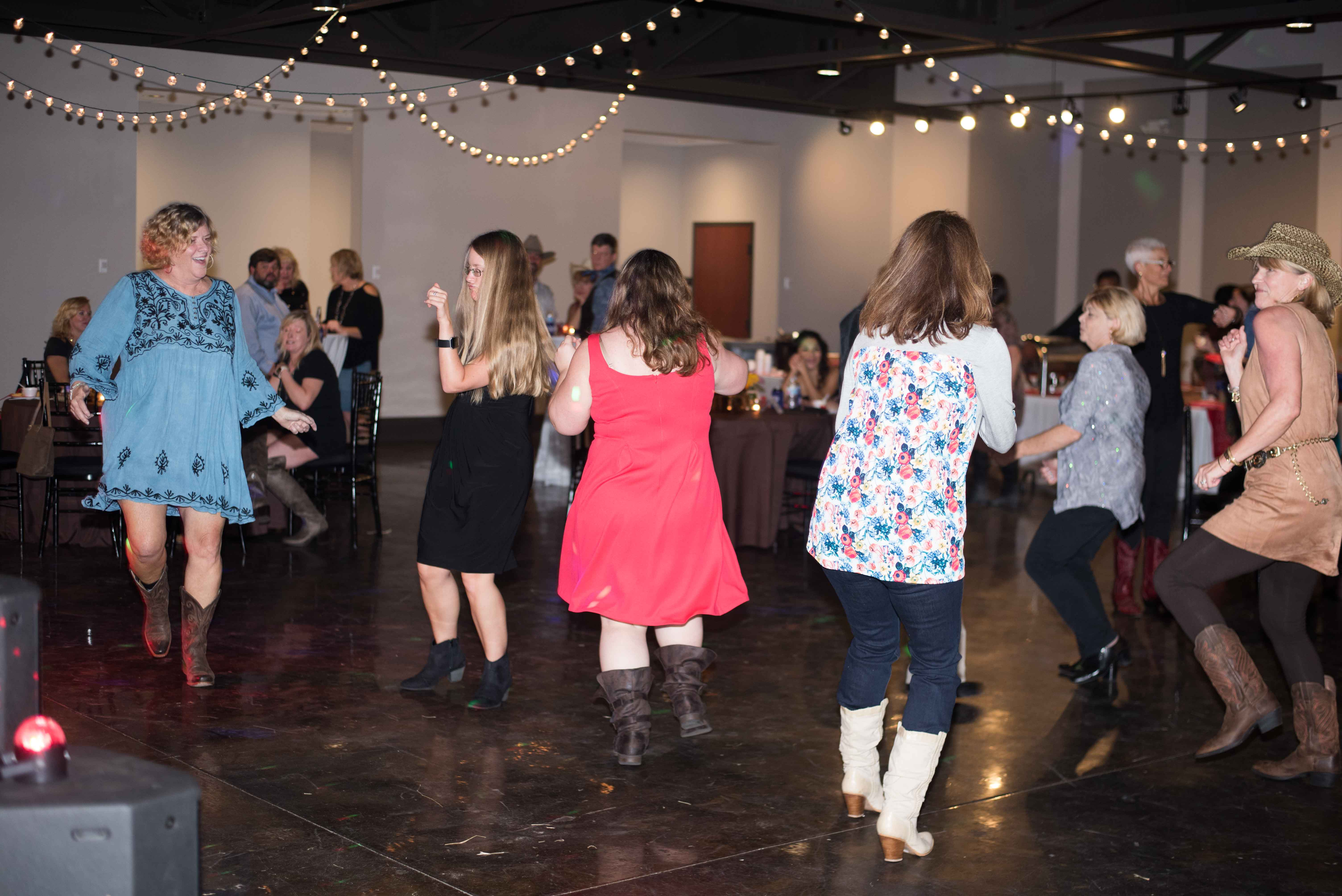 YMCA puts on fun night of boots, bling and dancing
